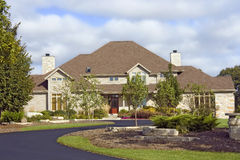 Rustic Stone Estate With Asphalt Driveway Stock Image