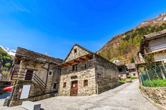 Rustic stone houses in Sonogno. Traditional rustic stone houses in Sonogno village in Locarno district, Switzerland, wide angle view Stock Photography