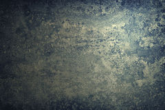 Rustic stone texture. Dark background. Vintage toned Royalty Free Stock Images