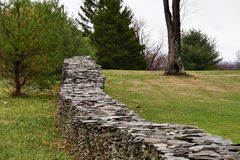 Rustic Stone Wall. A rustic stone wall made with stacked fieldstone in a rural, country setting Royalty Free Stock Photos