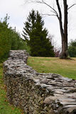 Rustic Stone Wall. A rustic stone wall made with stacked fieldstone in a rural, country setting Royalty Free Stock Image