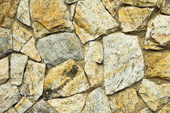 Rustic stone wall. A wall of stones handmade alocated Stock Photos