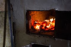 Rustic stove, live coals stock photography