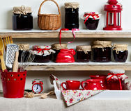 A rustic style. Ceramic tableware and kitchenware in red on the Stock Image