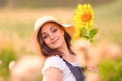 Rustic style. Girl with sunflowers in the field. Summer fields.Rustic style. Girl with sunflowers in the field stock photo