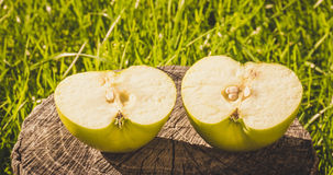 The rustic style. Half green Apple on the background of an old wood Stock Photo
