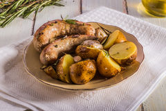 Rustic style potatoes and fried sausages Stock Images