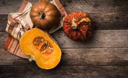 Rustic style pumpkins  with napkin and wood Royalty Free Stock Image