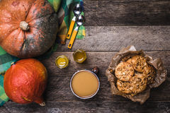 Rustic style pumpkins, soup, honey and cookies with nuts on wood Royalty Free Stock Images