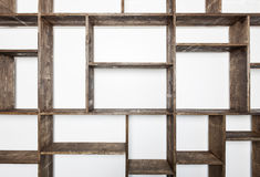 Rustic style shelves on white wall royalty free stock photo