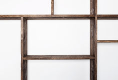 Rustic style shelves on white wall Stock Photos