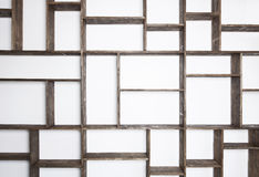 Rustic style shelves on white wall stock images