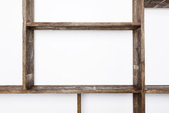 Rustic style shelves on white wall Royalty Free Stock Images