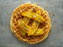Rustic sweet banana waffle with syrup Royalty Free Stock Photography