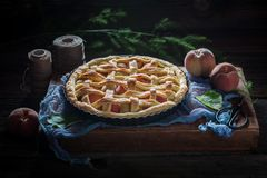 Rustic and sweet peaches pie made of fresh ingredients Stock Photography