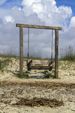 Rustic swing on beach Stock Images