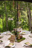 Rustic Table Centerpiece with Chandelier. On mossy mat stock photos