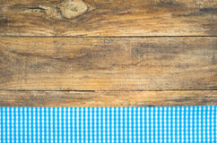 Rustic table cloth blue checkered on wood. Table with tablecloth light blue checkered pattern on rustic brown wood Royalty Free Stock Images