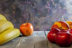 Rustic table with colorful fruits. Dark food on wooden background. Horizontal format Free space for designers. Copy space royalty free stock photo