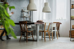 Rustic table in dining room Royalty Free Stock Photos