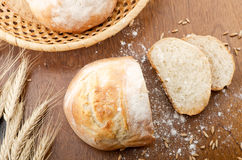 Rustic table with fresh bread Stock Images