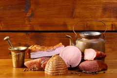 Rustic table with ham and bacon Stock Photo