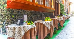 Rustic table in a narrow street in Sorrento. Campania, Italy royalty free stock images