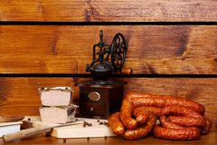 Rustic table with sausage and roast royalty free stock photo