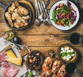 Rustic table set with meat, cheese, snacks, wine, copy space Royalty Free Stock Photos