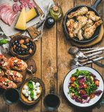 Rustic table set with meat, cheese, snacks, wine, copy space Royalty Free Stock Photography