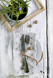 Rustic table setting. On white wooden table with wooden decor and crocus flowers royalty free stock photography