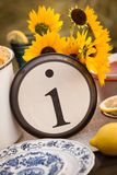 Rustic table setting with lettered plate. Beautiful rustic table setting with the letter I incorporated Royalty Free Stock Photos