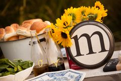 Rustic table setting with lettered plate. Beautiful rustic table setting with the letter `M` incorporated Royalty Free Stock Image