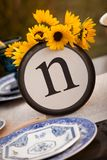Rustic table setting with lettered plate. Beautiful rustic table setting with the letter `N` incorporated Royalty Free Stock Image