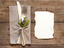 Rustic Table setting and old burned paper. On old wooden table royalty free stock photography