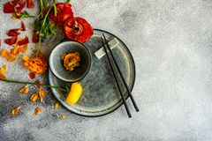 Rustic table setting. With ranunculus flowers on concrete background with copy space royalty free stock photography