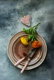 Rustic table setting. With ranunculus flowers on concrete background with copy space stock image