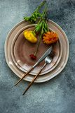 Rustic table setting. With ranunculus flowers on concrete background with copy space stock photos