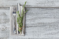 Rustic table setting with rosemary. On light wooden table with copyspace. Holidays decoration on Provence style. Romantic dinner. Top view with free space stock images