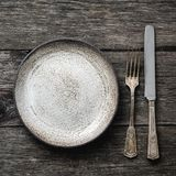Rustic table setting, vintage cutlery or silverware. Square crop, top view royalty free stock photo