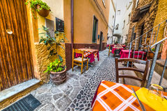 Rustic tables in Castelsardo Royalty Free Stock Image