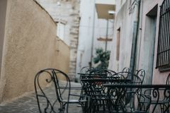 Rustic tables in Castelsardo old town, Sardinia, Italy stock photo