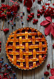Rustic Thanksgiving american raspberry pie preparation with jam and raspberries on wooden kitchen table background. Royalty Free Stock Photos