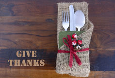 Rustic Thanksgiving burlap wrapped place setting. Royalty Free Stock Photos