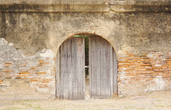 Rustic timber arch door Stock Photography