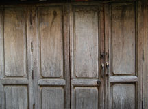 Rustic timber door. At the old house Stock Image