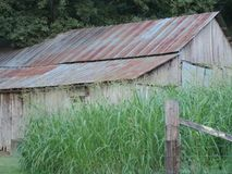 Rustic Tin roof barn. Tin roof barn in middle of field Stock Photo