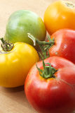 Rustic tomatoes. A mix of red, green, and yellow Royalty Free Stock Photos
