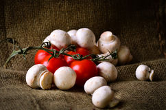 Rustic tomatoes and mushrooms. Royalty Free Stock Photo