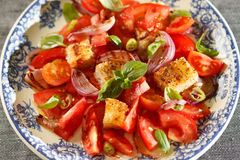 Rustic tomatoes salad Stock Photo